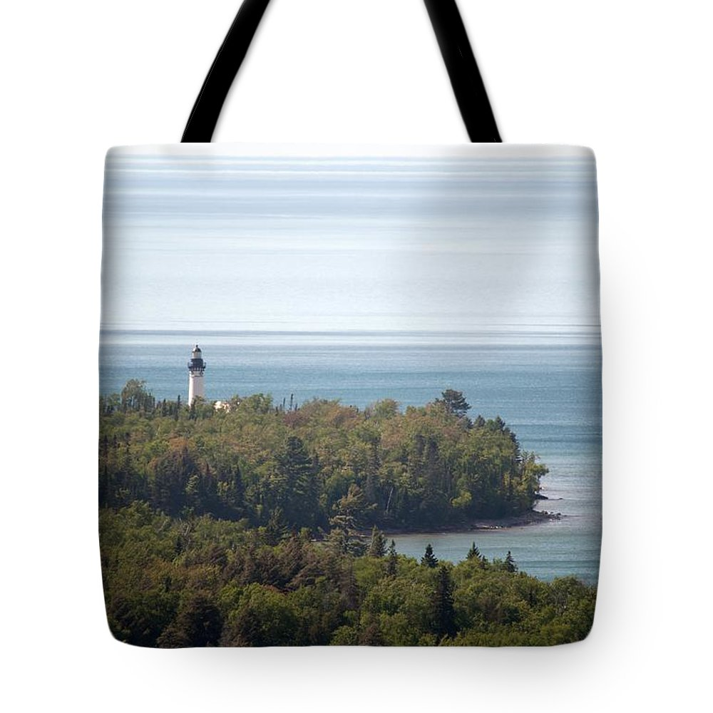 Au Sable Lighthouse Tote Bag featuring the photograph Au Sable Lighthouse by Linda Kerkau