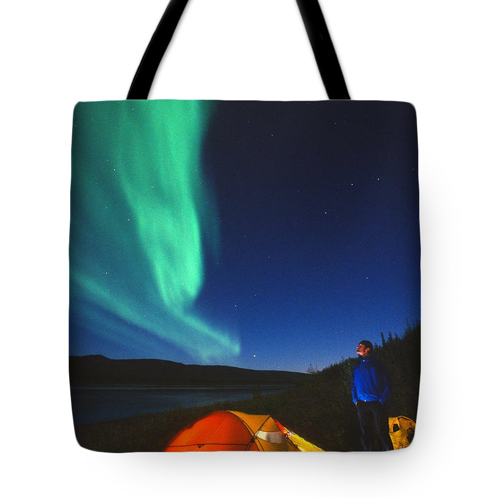 Light Tote Bag featuring the photograph Aurora Borealis Above A Tent And Camper by Peter Mather