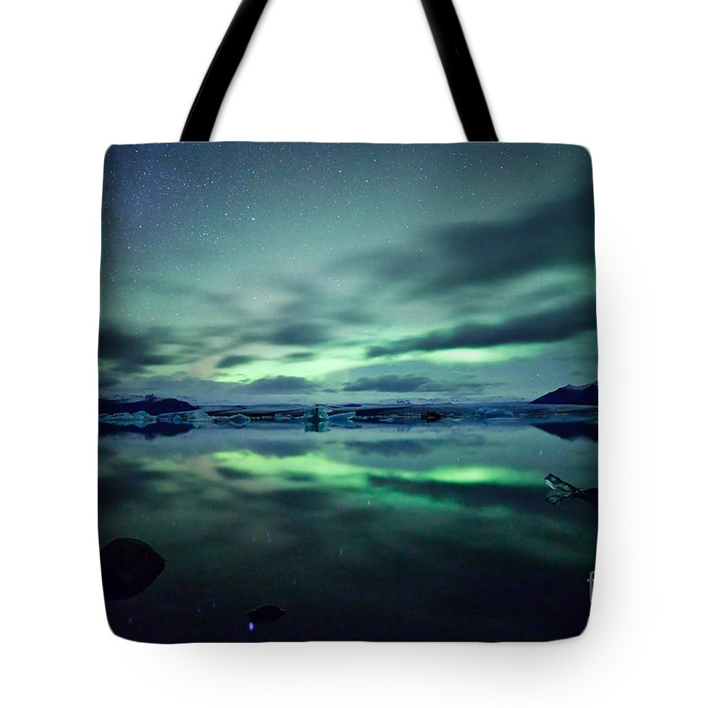 Aurora Tote Bag featuring the photograph Aurora Borealis Over Lake by Matteo Colombo