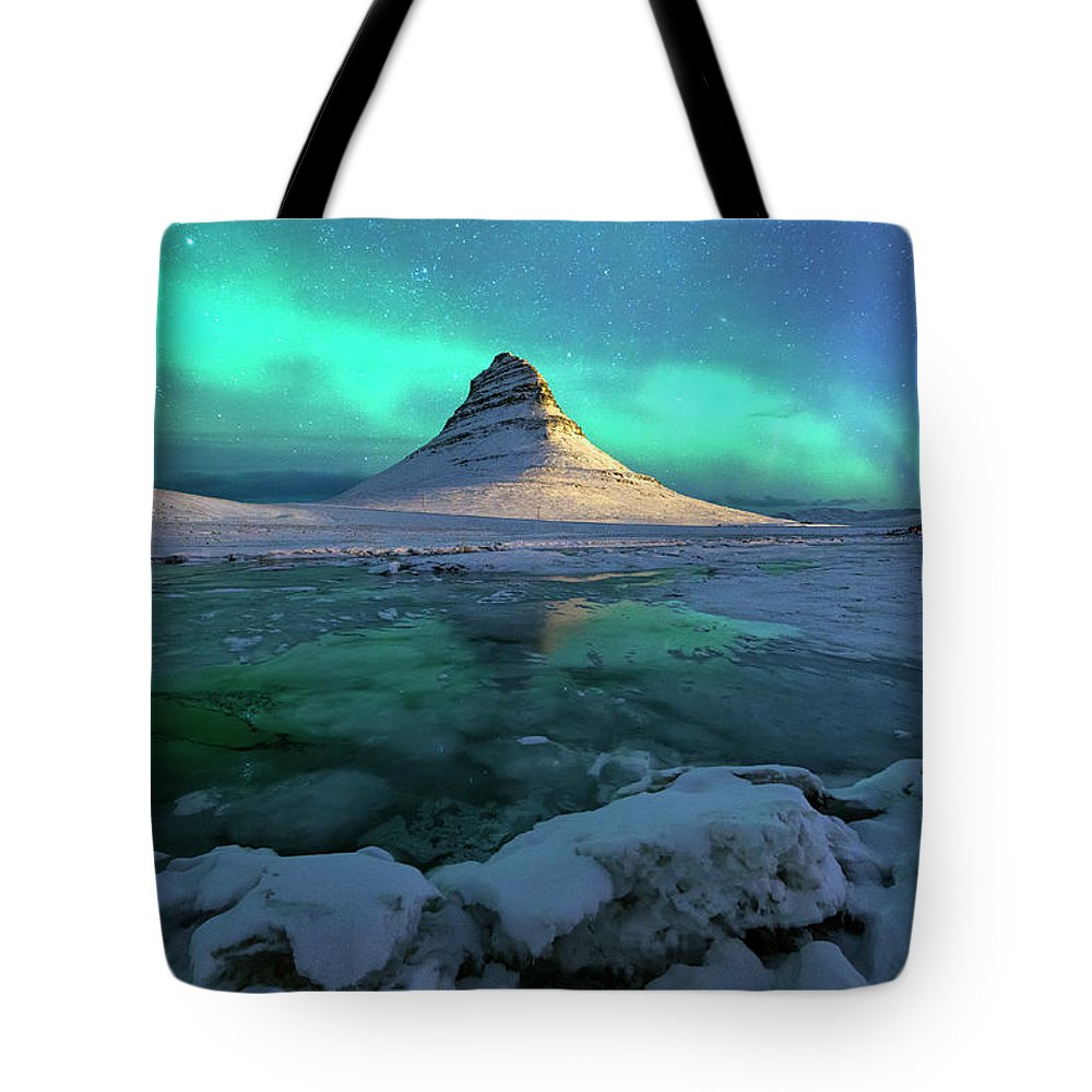 Tranquility Tote Bag featuring the photograph Aurora Over Kirkjufell Mountain Iceland by Ratnakorn Piyasirisorost