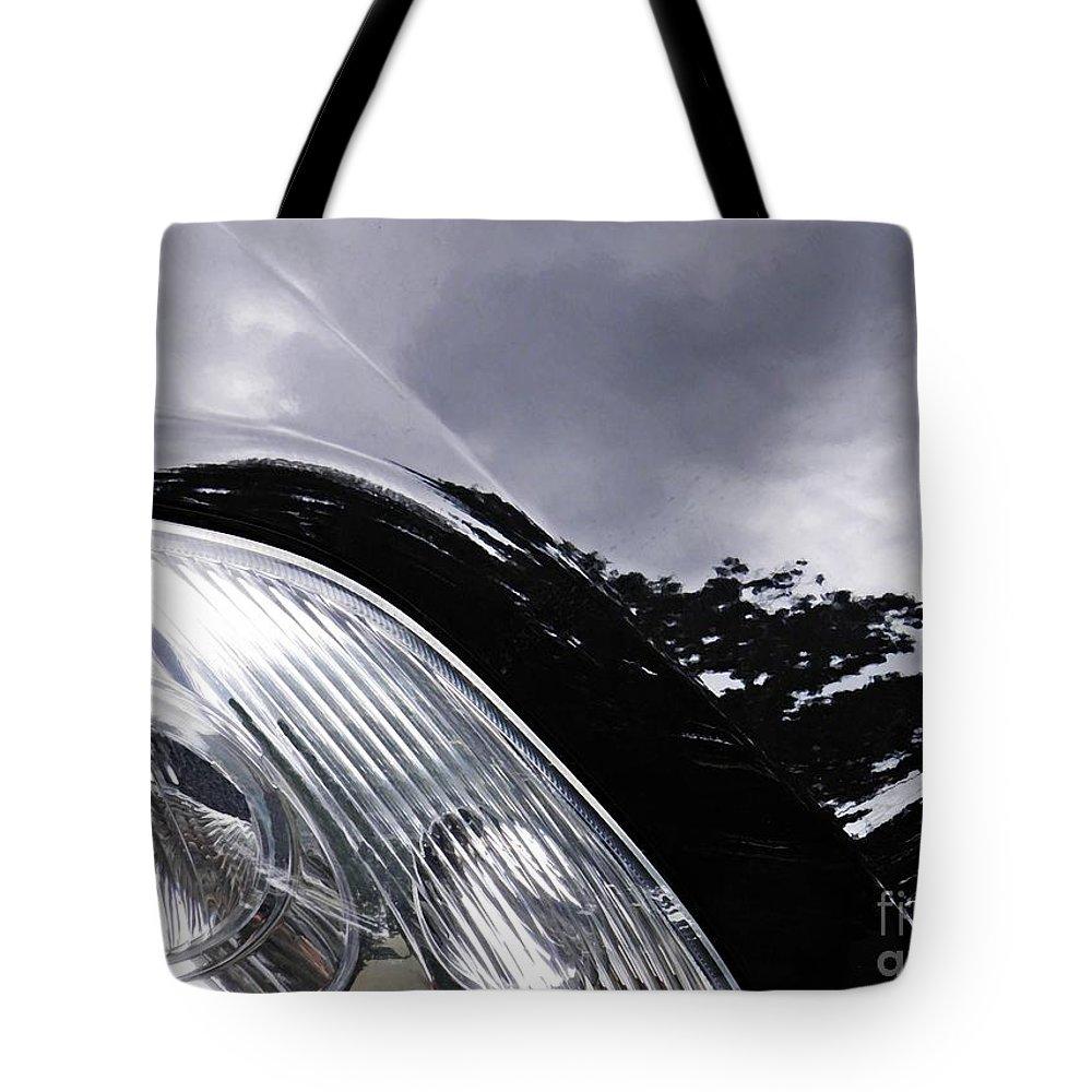 Headlight Tote Bag featuring the photograph Auto Headlight 150 by Sarah Loft