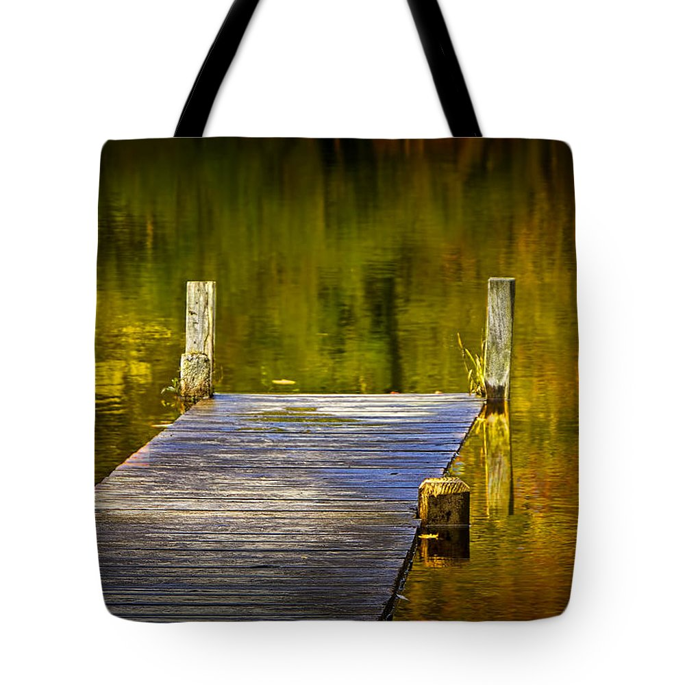 Art Tote Bag featuring the photograph Autumn Reflections And Boat Dock On A Pond Near Yankee Springs Michigan by Randall Nyhof