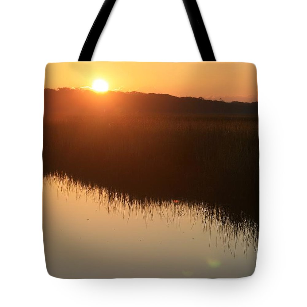 Sunrise Tote Bag featuring the photograph Autumn Sunrise Over The Marsh by Nadine Rippelmeyer
