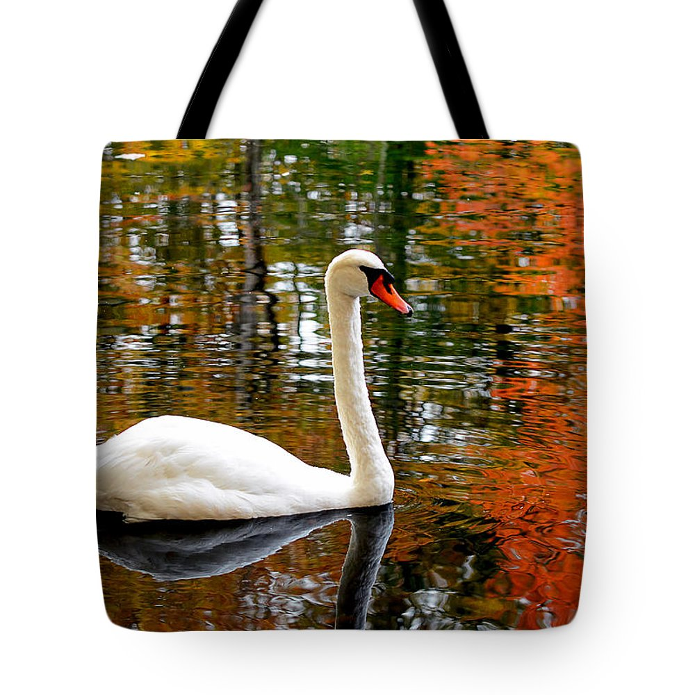 Autumn Swan Tote Bag featuring the photograph Autumn Swan by Lourry Legarde