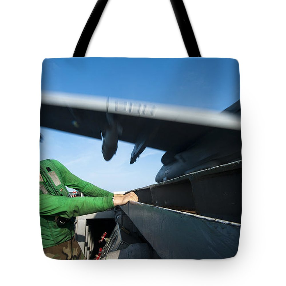 Military Tote Bag featuring the photograph Aviation Boatswains Mate Ducks As An by Stocktrek Images