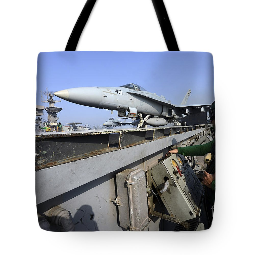 Military Tote Bag featuring the photograph Aviation Boatswains Mate Launches An by Stocktrek Images