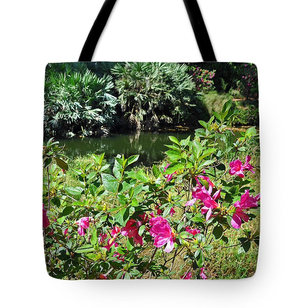 Landscapes Tote Bag featuring the photograph Azaleas By The Pond by Deborah Good
