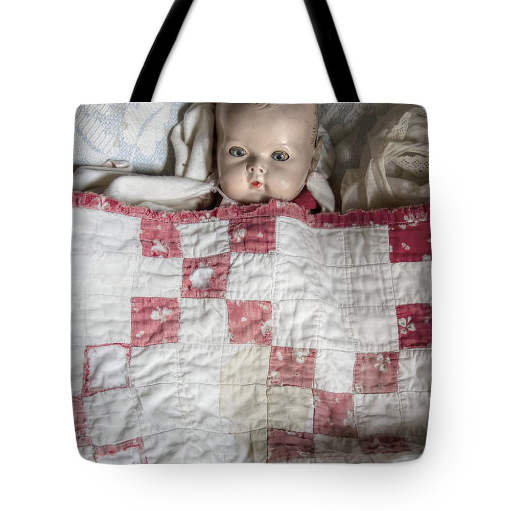 Old; Antique; Childhood; Doll; Eerie; Eyes; Face; Gazing; Heirloom; Nostalgia; Old; Retro; Staring; Toy; Vintage; Female; Male; Girl; Boy; Porcelain; Eyes; Blanket; Bed; Crib; Play; Playing; Quilt; Baby Tote Bag featuring the photograph Baby Doll by Margie Hurwich