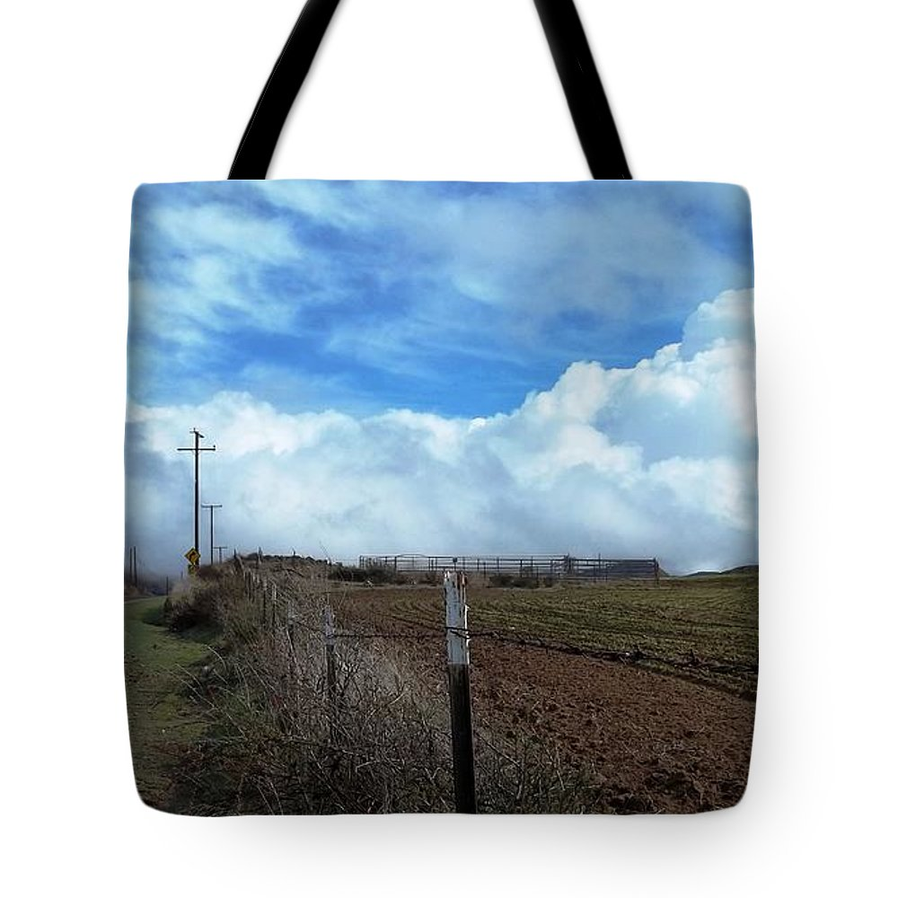 Billowing Clouds Tote Bag featuring the photograph Backroads- Telephone Poles- And Barbed Wire Fences by Glenn McCarthy Art and Photography