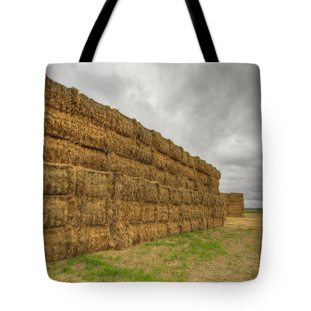 Bales Tote Bag featuring the photograph Bales Of Hay On Farmland 4 by David Gn
