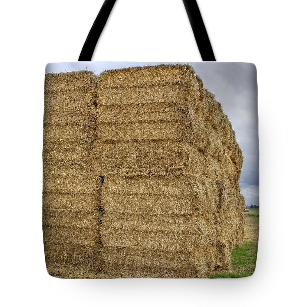 Bales Tote Bag featuring the photograph Bales Of Hay On Farmland by David Gn