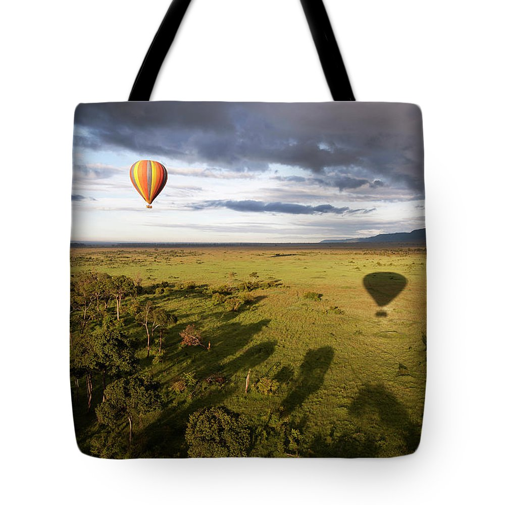 Kenya Tote Bag featuring the photograph Balloon In Masai Mara National Park by Luis Davilla