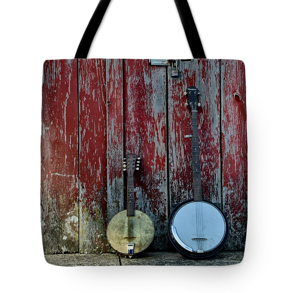 Banjos Against A Barn Door Tote Bag featuring the photograph Banjos Against A Barn Door by Bill Cannon