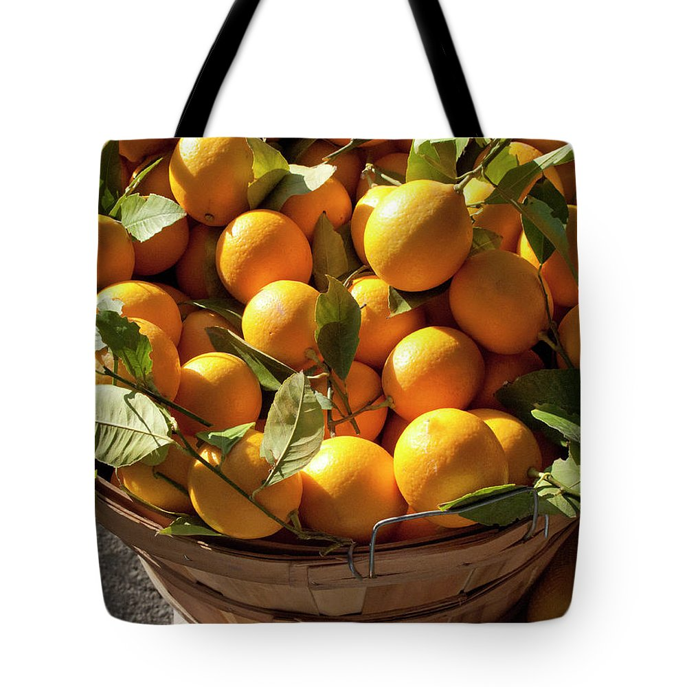Orange Tote Bag featuring the photograph Basket Of Fresh Picked Oranges by Bill Boch