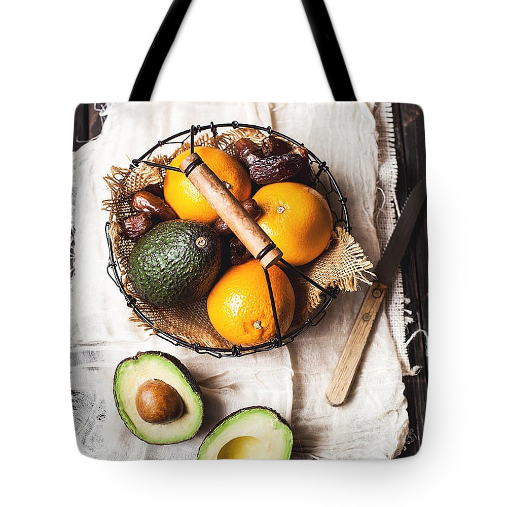 San Francisco Tote Bag featuring the photograph Basket With Avocado, Oranges And Dates by One Girl In The Kitchen