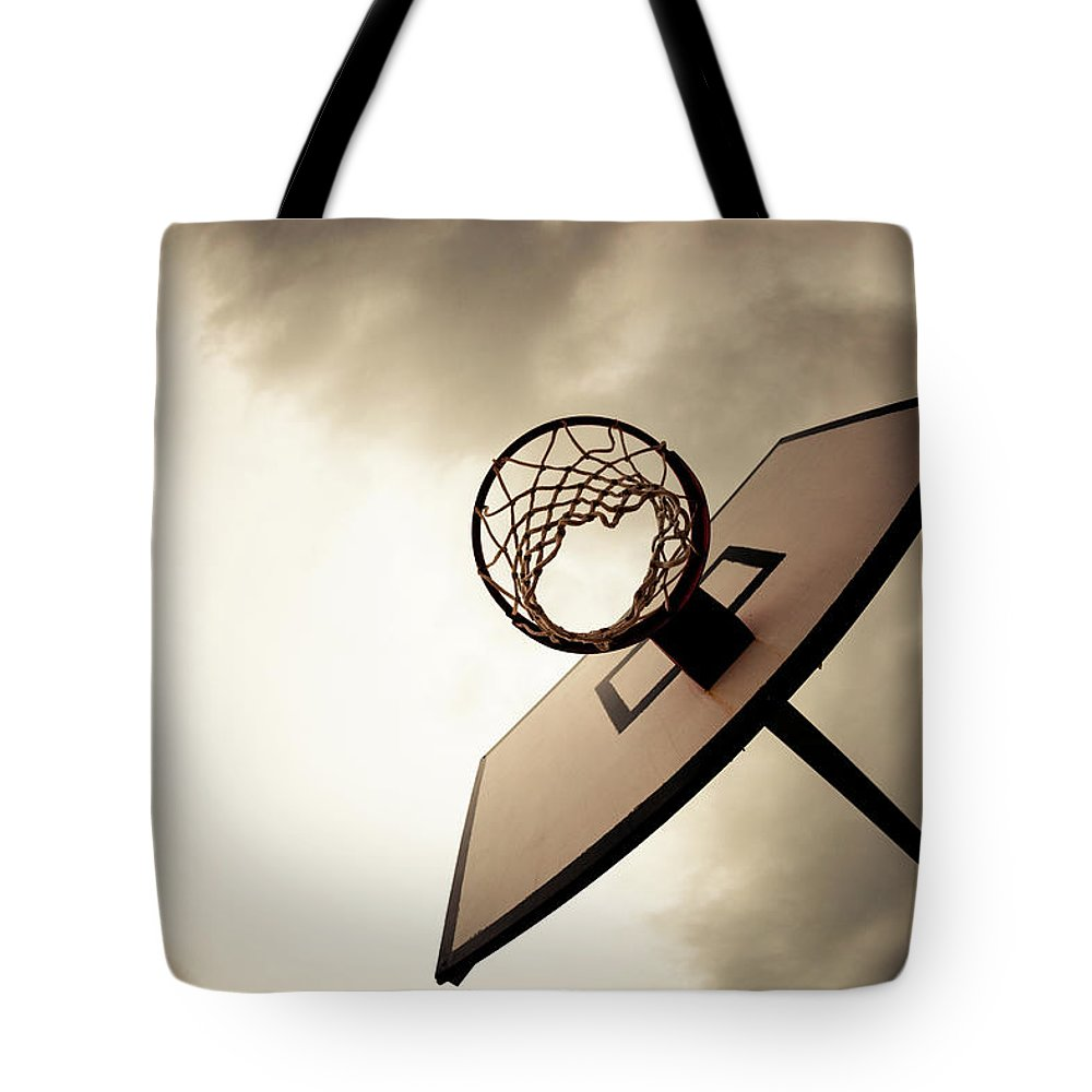 Goal Tote Bag featuring the photograph Basketball Hoop, Dramatic Sky by Zodebala