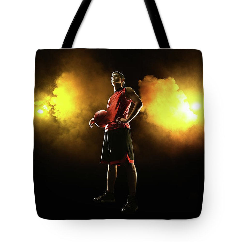 People Tote Bag featuring the photograph Basketball Player On Smoky Yellow by Stanislaw Pytel