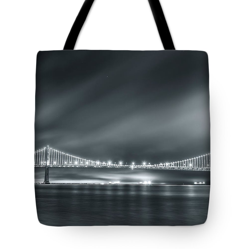 City Tote Bag featuring the photograph Bay Bridge And The Fog by Jonathan Nguyen