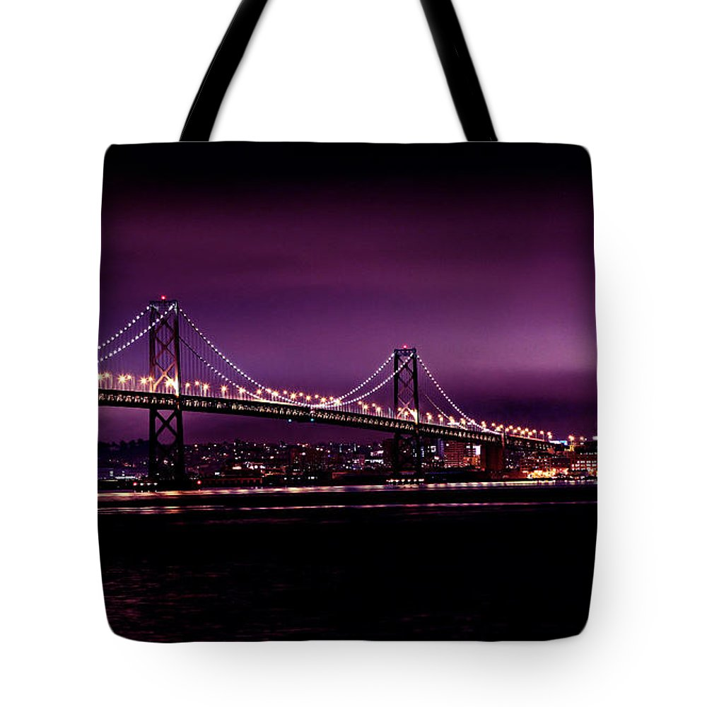 Urban Landscapes Tote Bag featuring the photograph Bay Bridge Purple Haze by Digital Kulprits