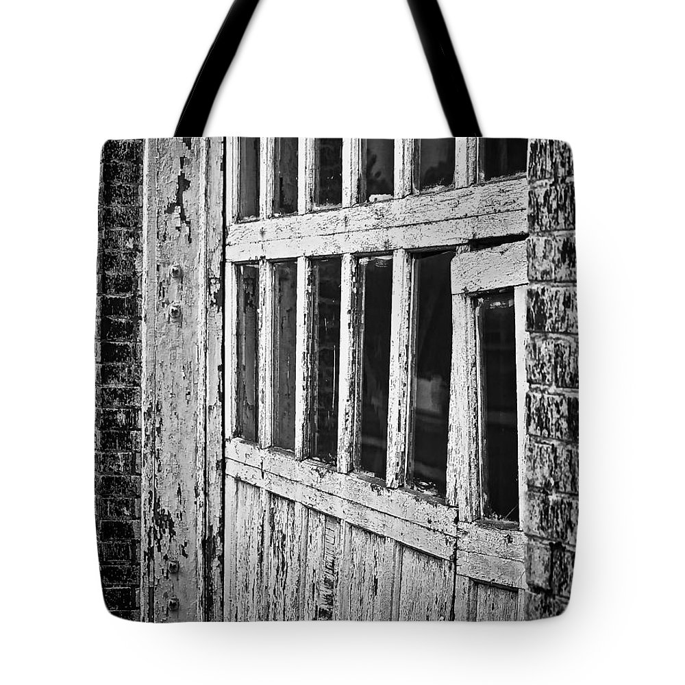 Bay Door In B/w Tote Bag featuring the photograph Bay Door In B/w by Greg Jackson