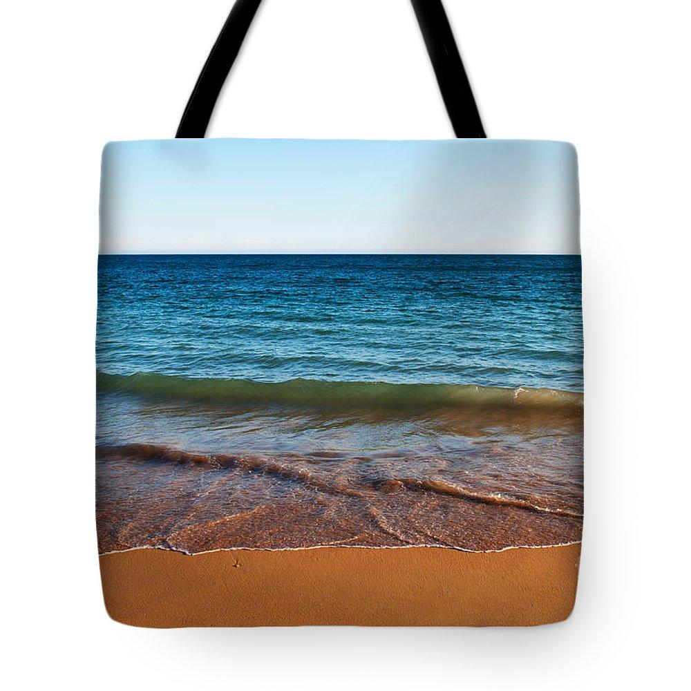 Beach Tote Bag featuring the photograph Beach In Algarve by Luis Alvarenga