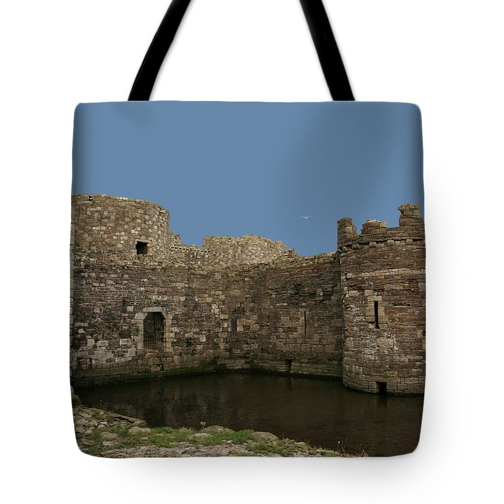 Castles Tote Bag featuring the photograph Beamaris Castle by Christopher Rowlands
