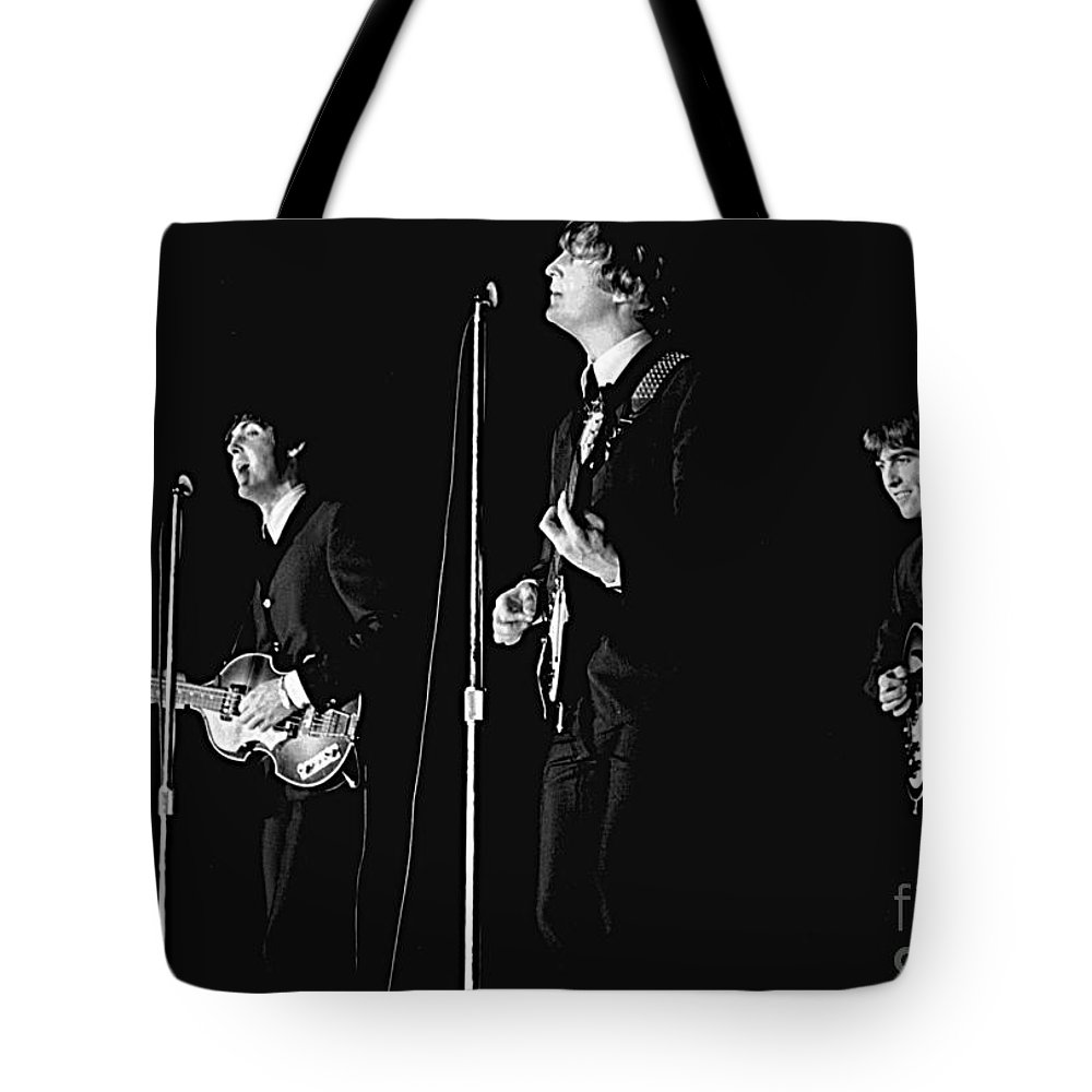 Beatles Tote Bag featuring the photograph Beatles In Concert, 1964 by Larry Mulvehill