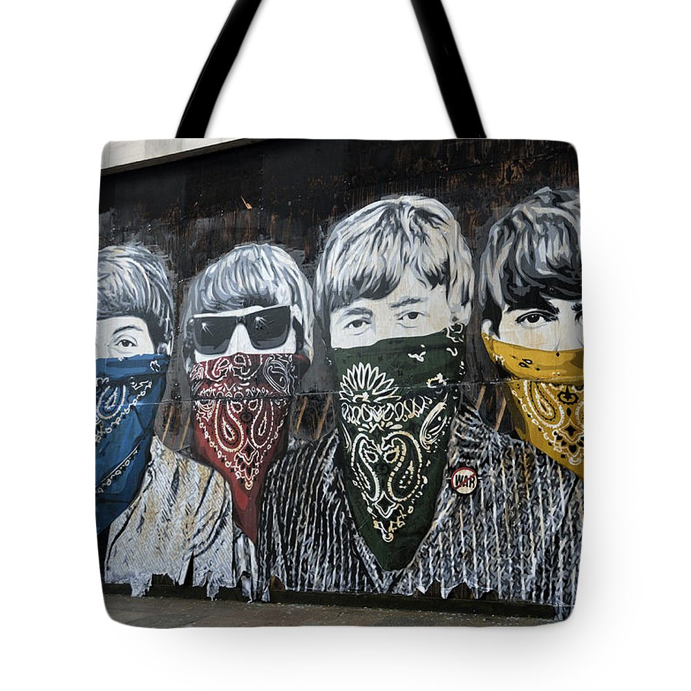 Banksy Tote Bag featuring the photograph The Beatles wearing face masks street mural by RicardMN Photography