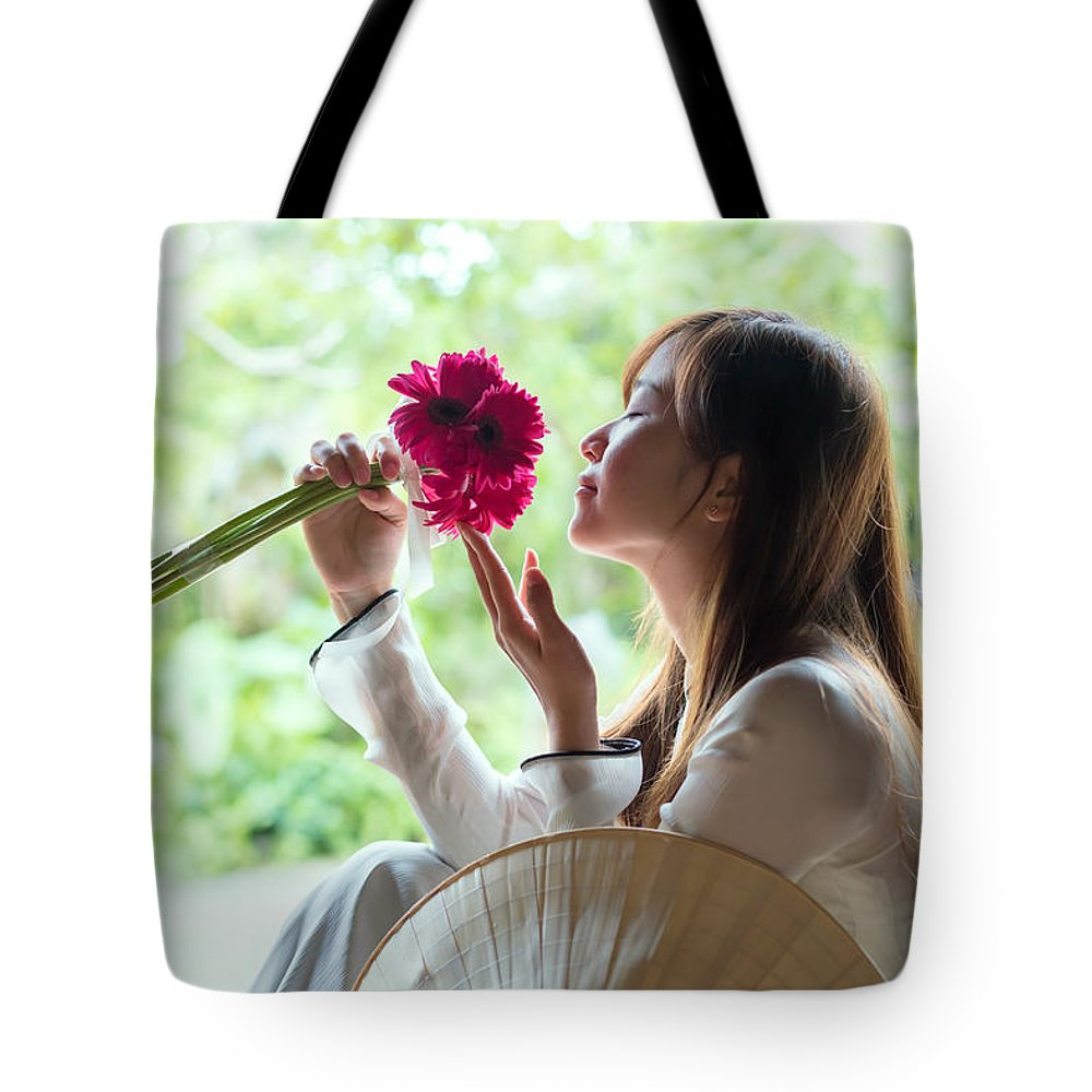 Beautiful Tote Bag featuring the photograph Beautiful Asian Woman With Flowers - Vietnam by Matteo Colombo