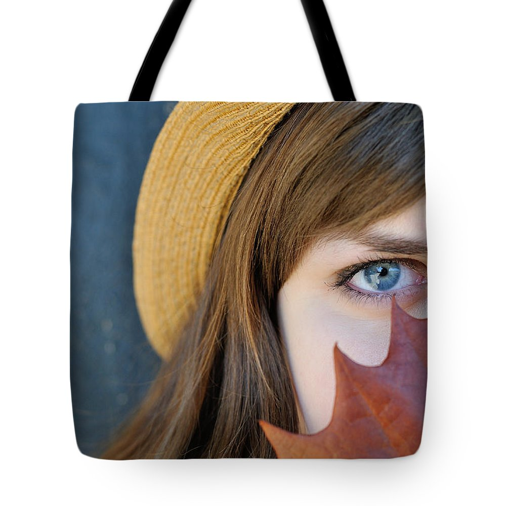 Women Tote Bag featuring the photograph Young Woman And Leaf by Patrick Herrera