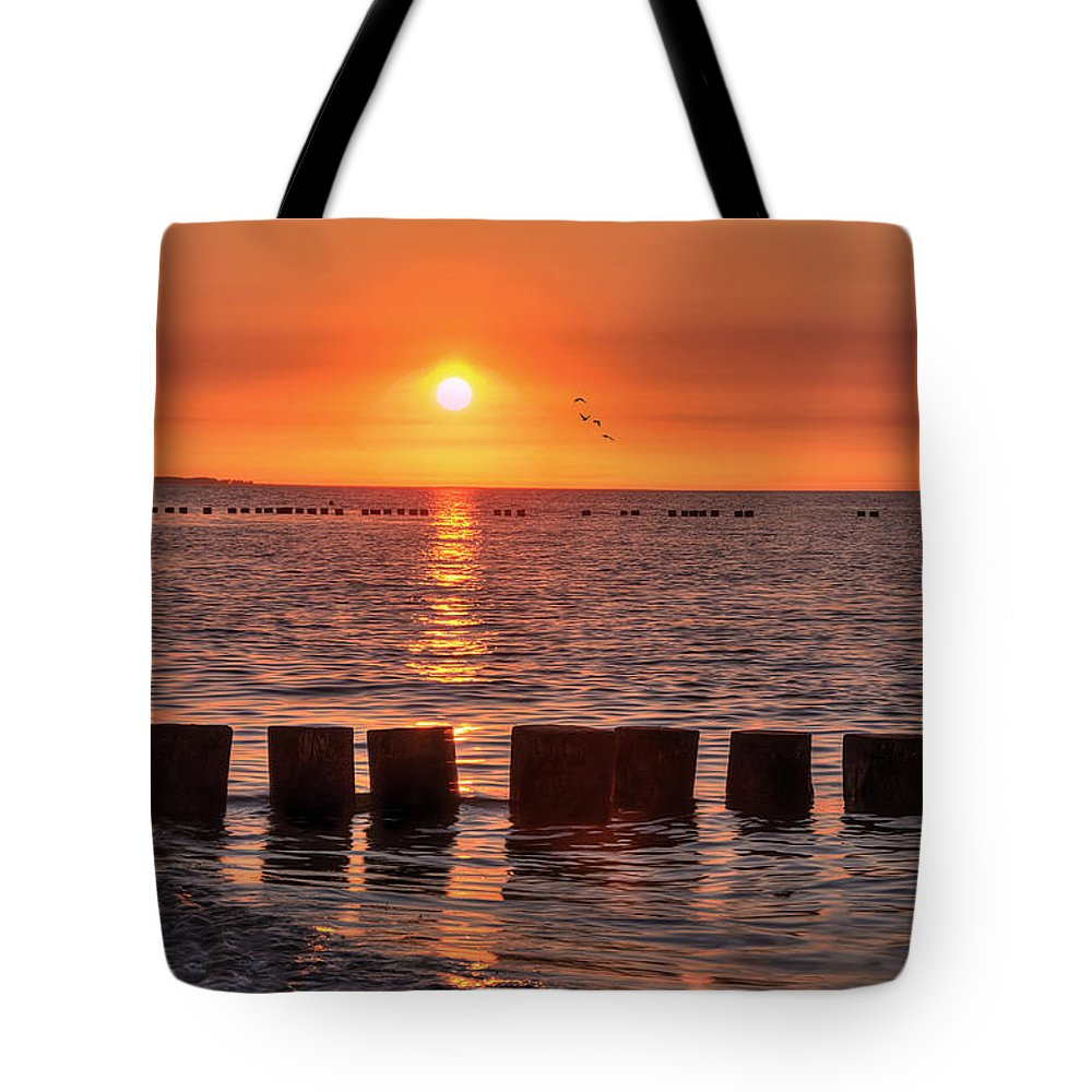 Ostsee Tote Bag featuring the pyrography Beautyful Sunset by Steffen Gierok