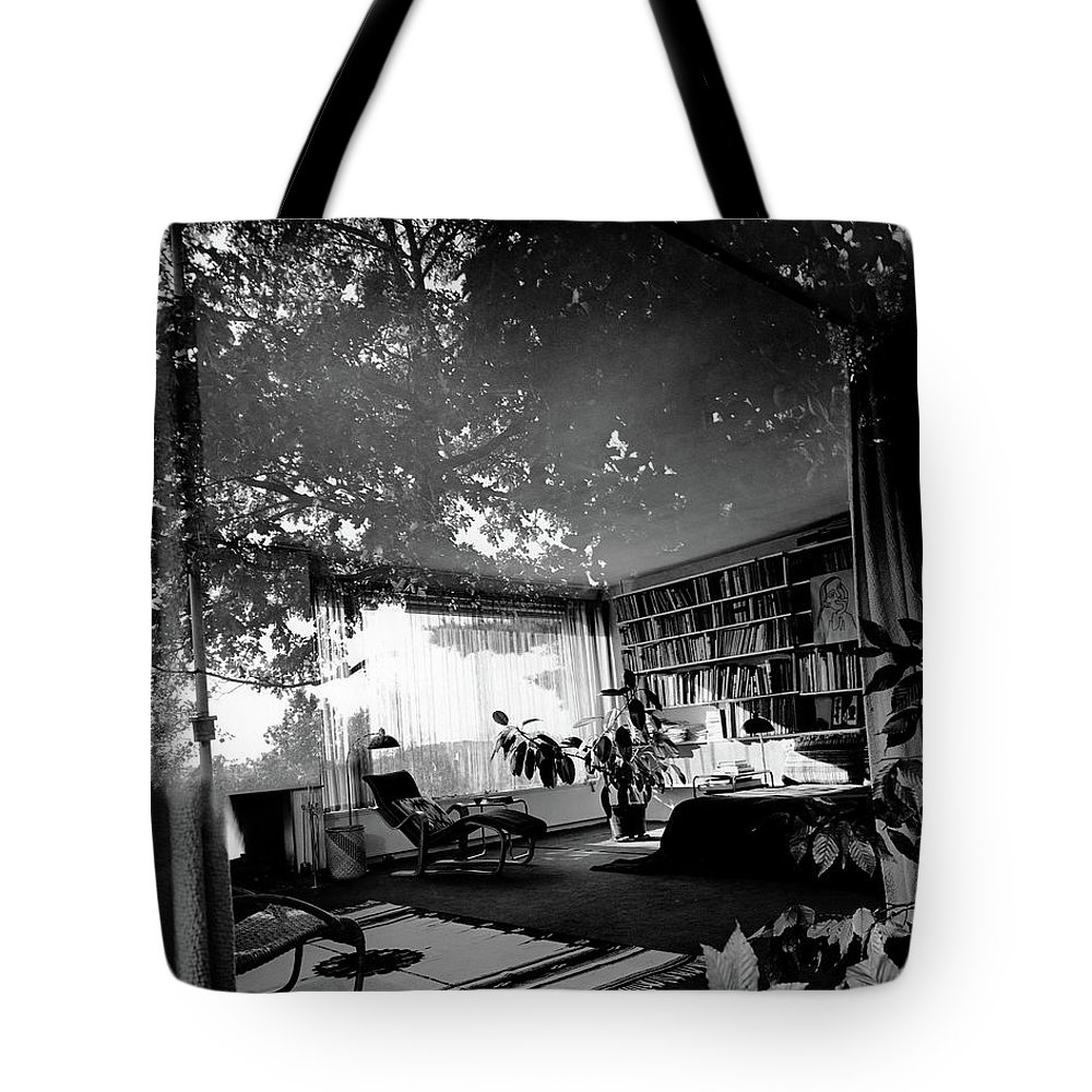 Home Tote Bag featuring the photograph Bedroom Seen Through Glass From The Outside by Robert M. Damora