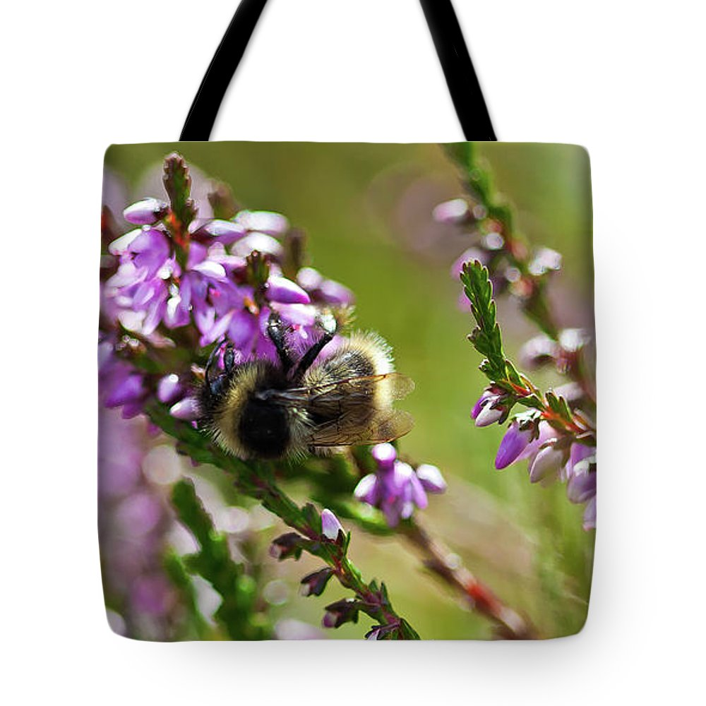 Animal Tote Bag featuring the photograph Bee On Heather by Roberto Pagani