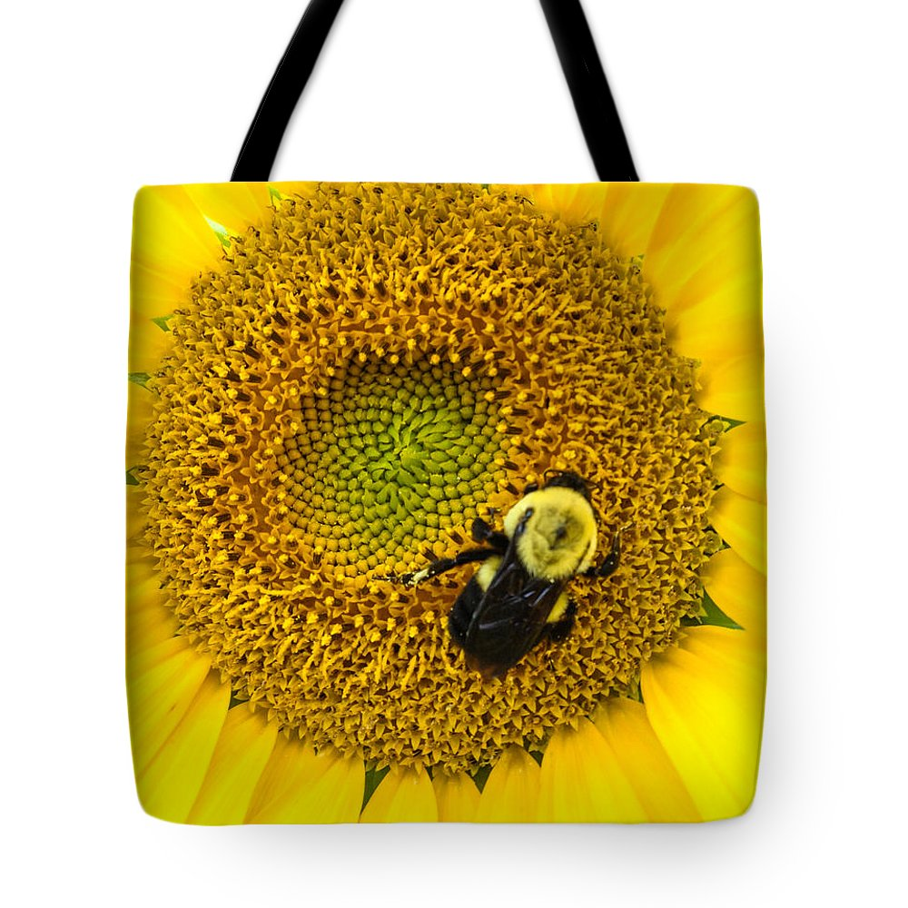 Yellow Tote Bag featuring the photograph Bee On Sunflower by Photographic Arts And Design Studio