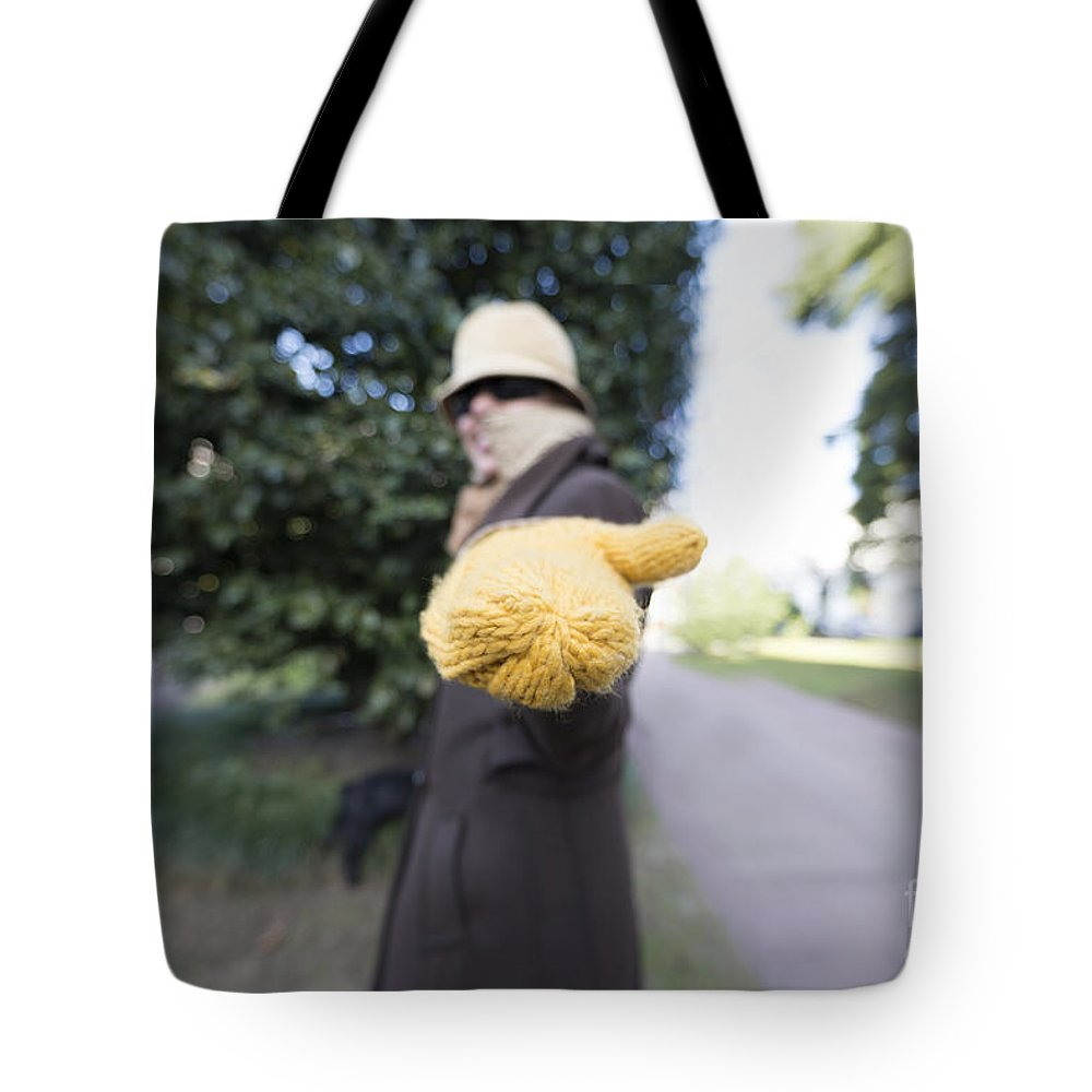 Woman Tote Bag featuring the photograph Begging For Money by Mats Silvan
