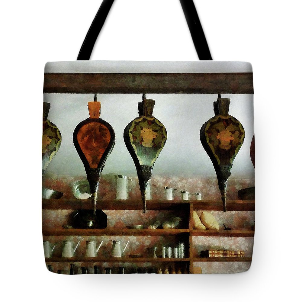 Shelf Tote Bag featuring the photograph Bellows In General Store by Susan Savad