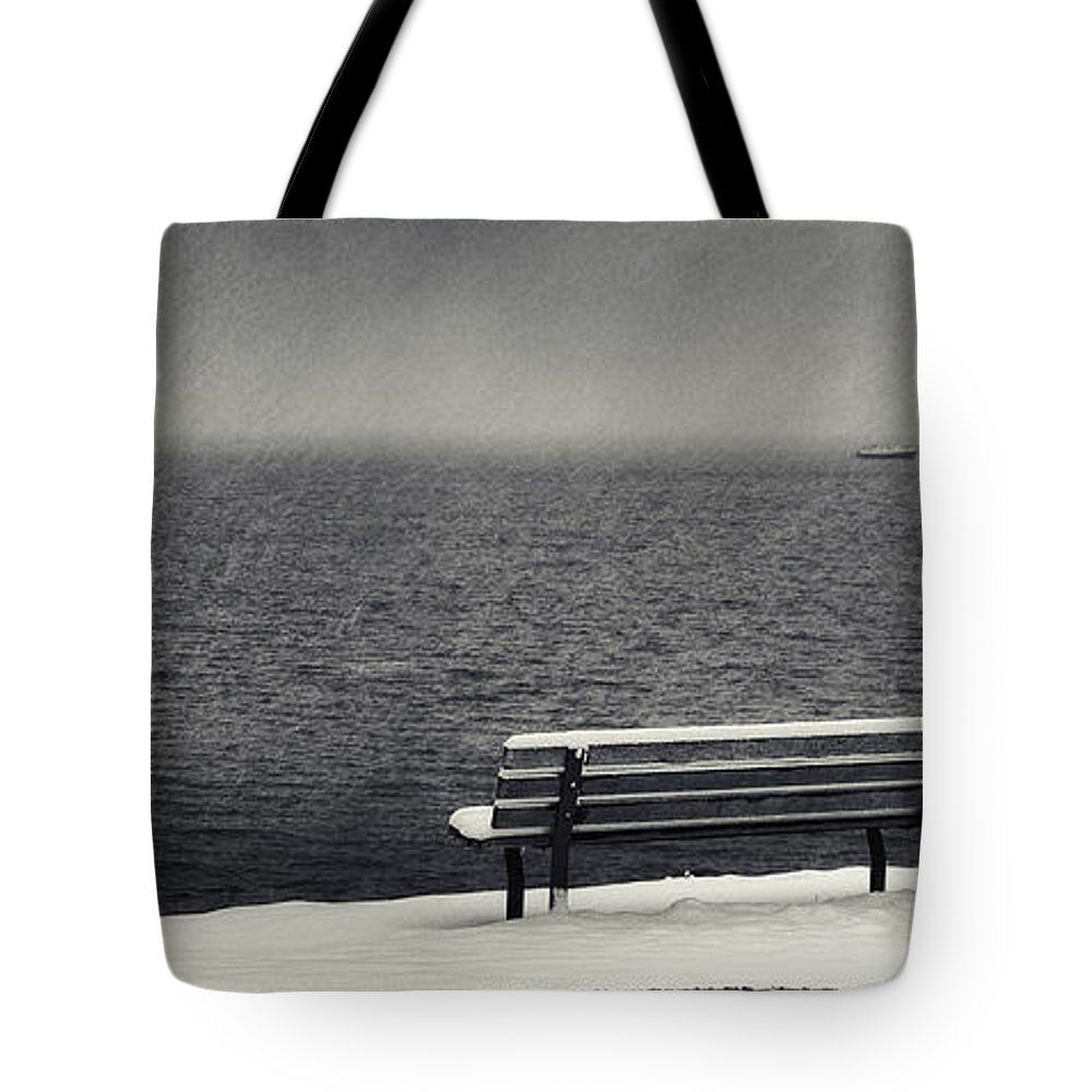 Bench Rock And Sailing Boat Tote Bag featuring the photograph Bench On The Winter Shore by Peter v Quenter