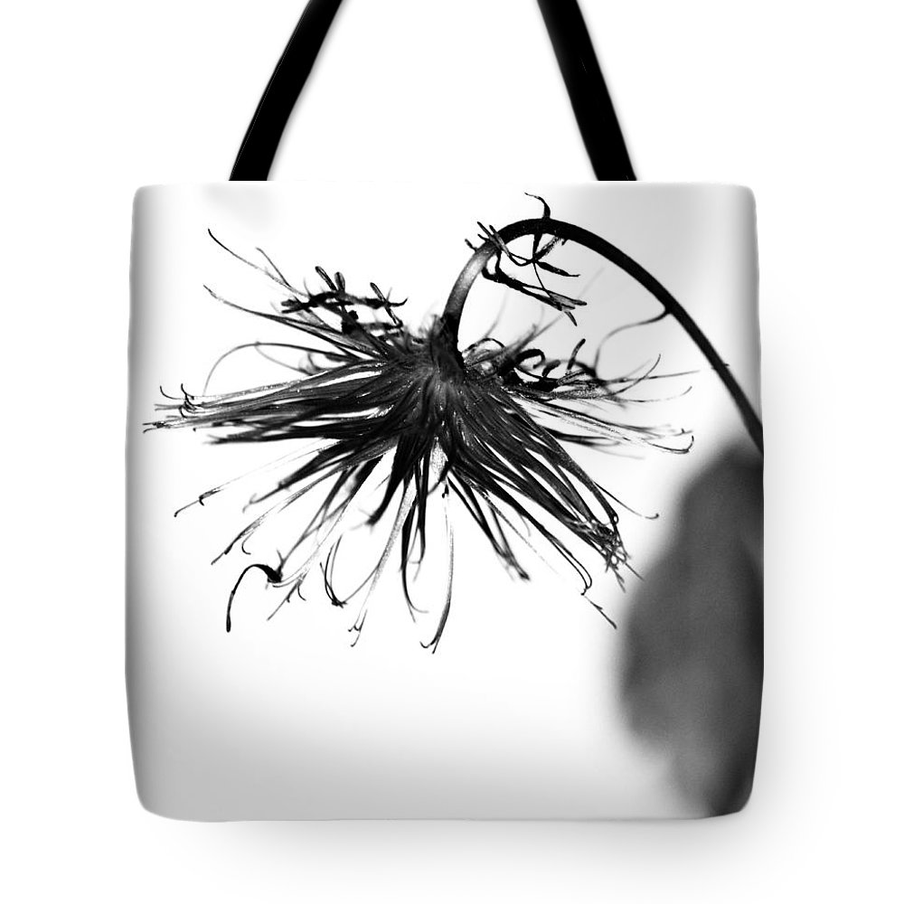 Flower Tote Bag featuring the photograph Bent To Embrace by The Artist Project