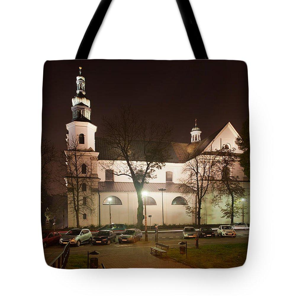 Krakow Tote Bag featuring the photograph Bernandine Church At Night In Krakow by Artur Bogacki