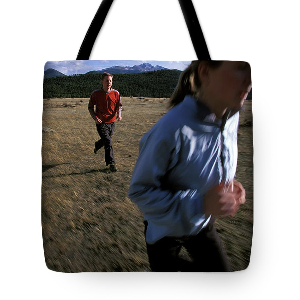 Beth Rodden Tote Bag featuring the photograph Beth Rodden And Tommy Caldwell Get by Corey Rich