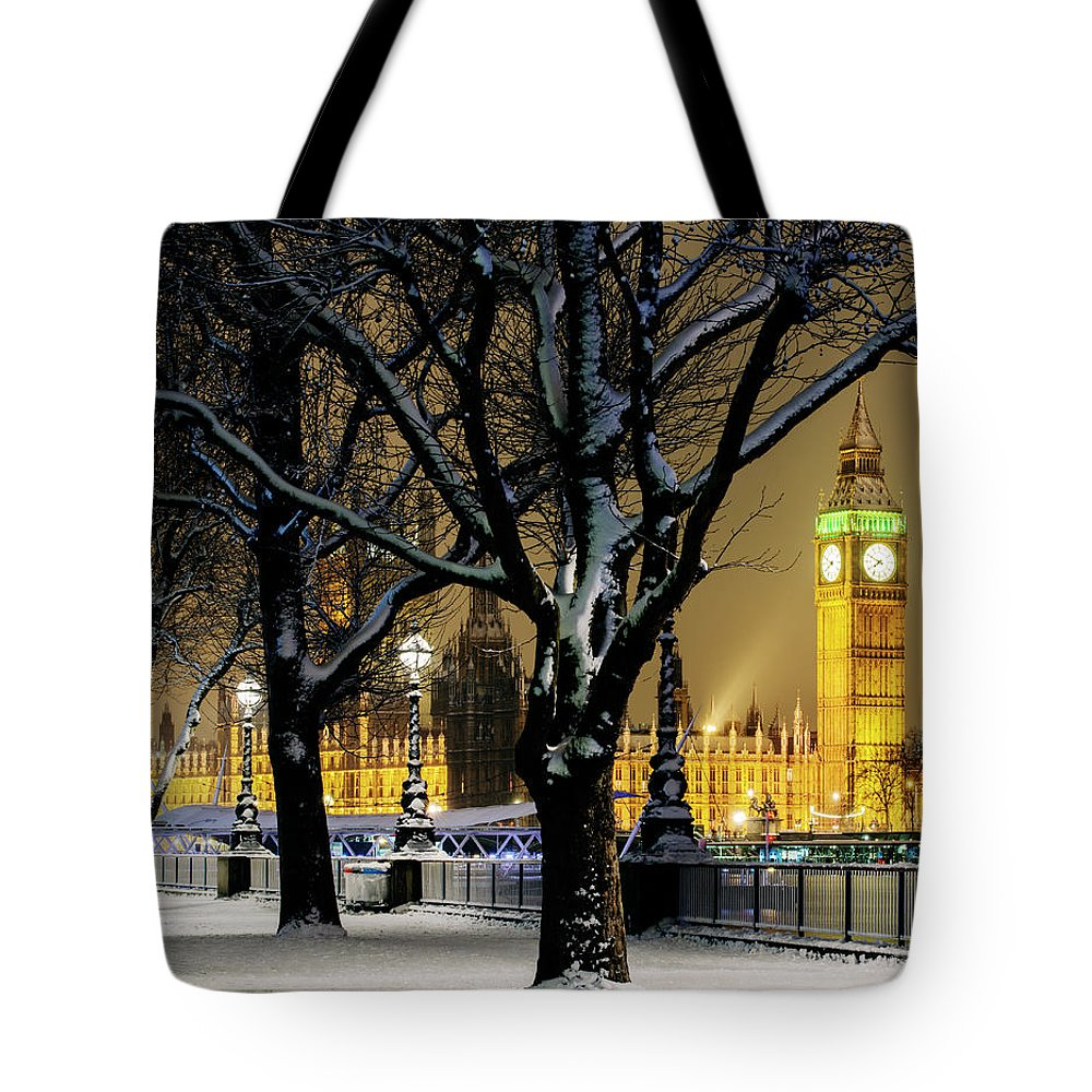 Tranquility Tote Bag featuring the photograph Big Ben And Houses Of Parliament In Snow by Shomos Uddin
