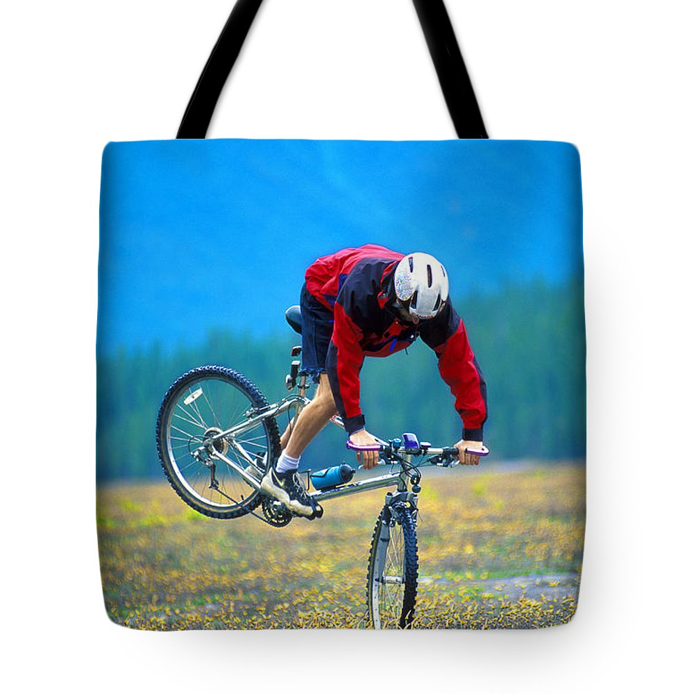 Crash Tote Bag featuring the photograph Bike Stunt by Corey Hochachka