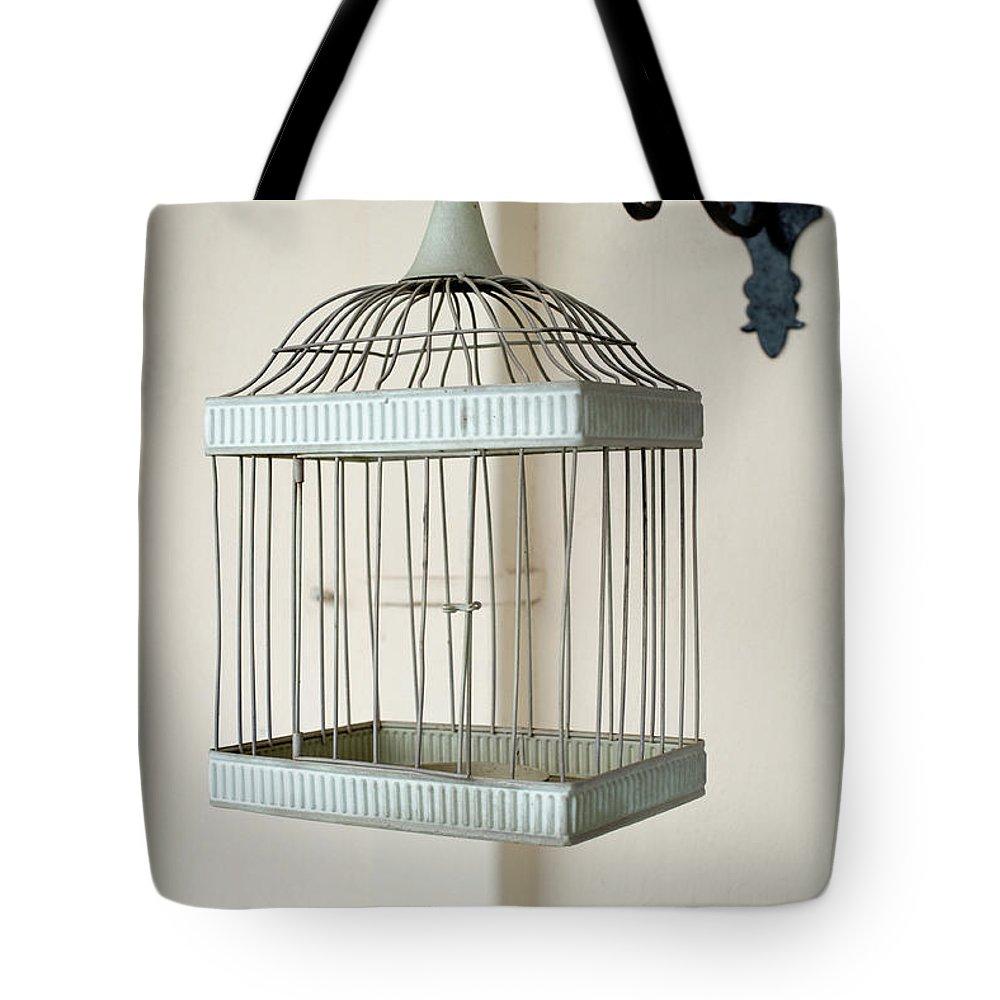 Birdcage Tote Bag featuring the photograph Birdcage by Grigorios Moraitis