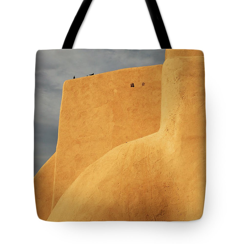 Built Structure Tote Bag featuring the photograph Birds Perched On A Yellow Building by Win-initiative