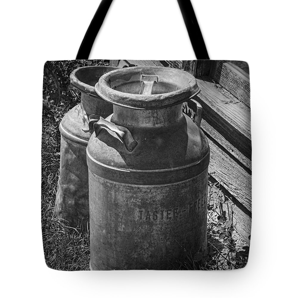 Creamery Can Tote Bag featuring the photograph Black And White Old Prairie Homestead Vintage Creamery Cans Near The Badlands by Randall Nyhof