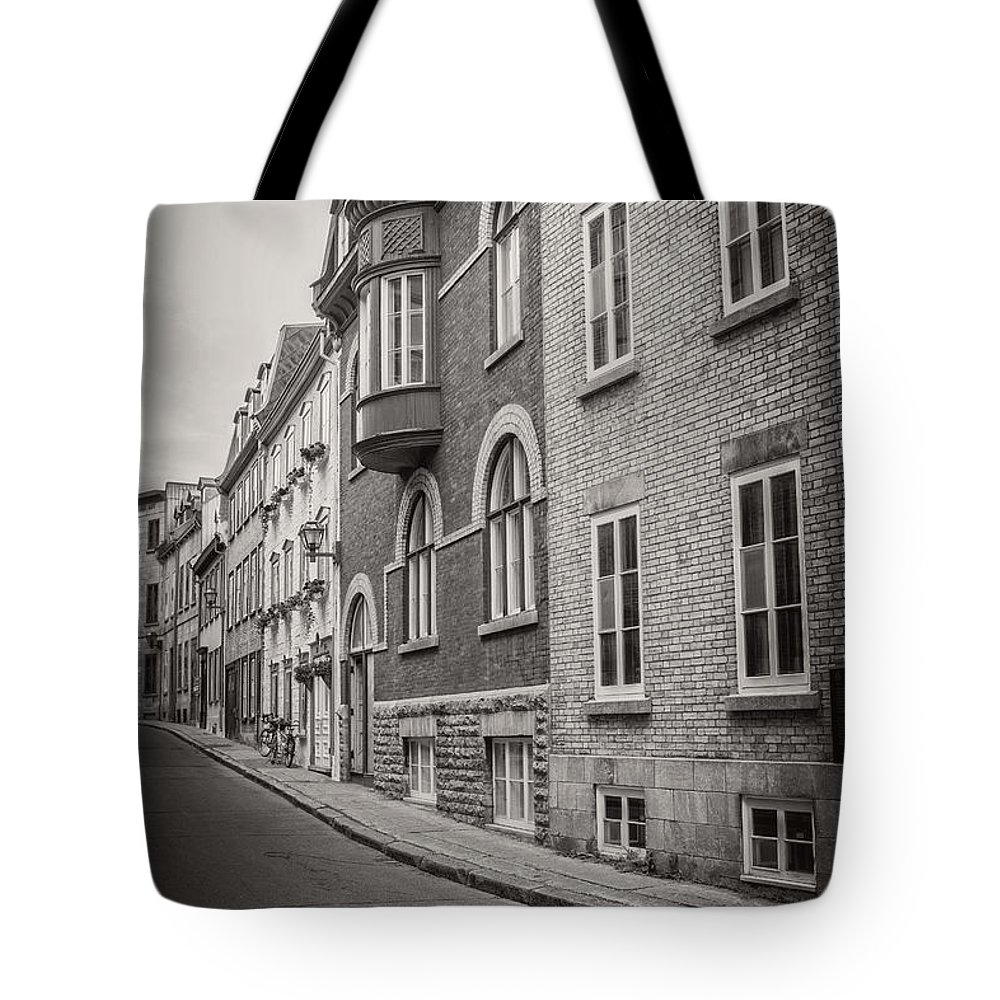 Canada Tote Bag featuring the photograph Black And White Old Style Photo Of Old Quebec City by Edward Fielding