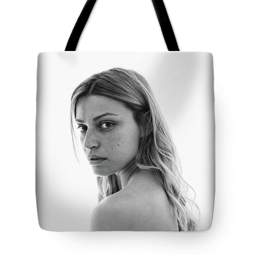 People Tote Bag featuring the photograph Black And White Portrait Of A Young by Aleksandarnakic