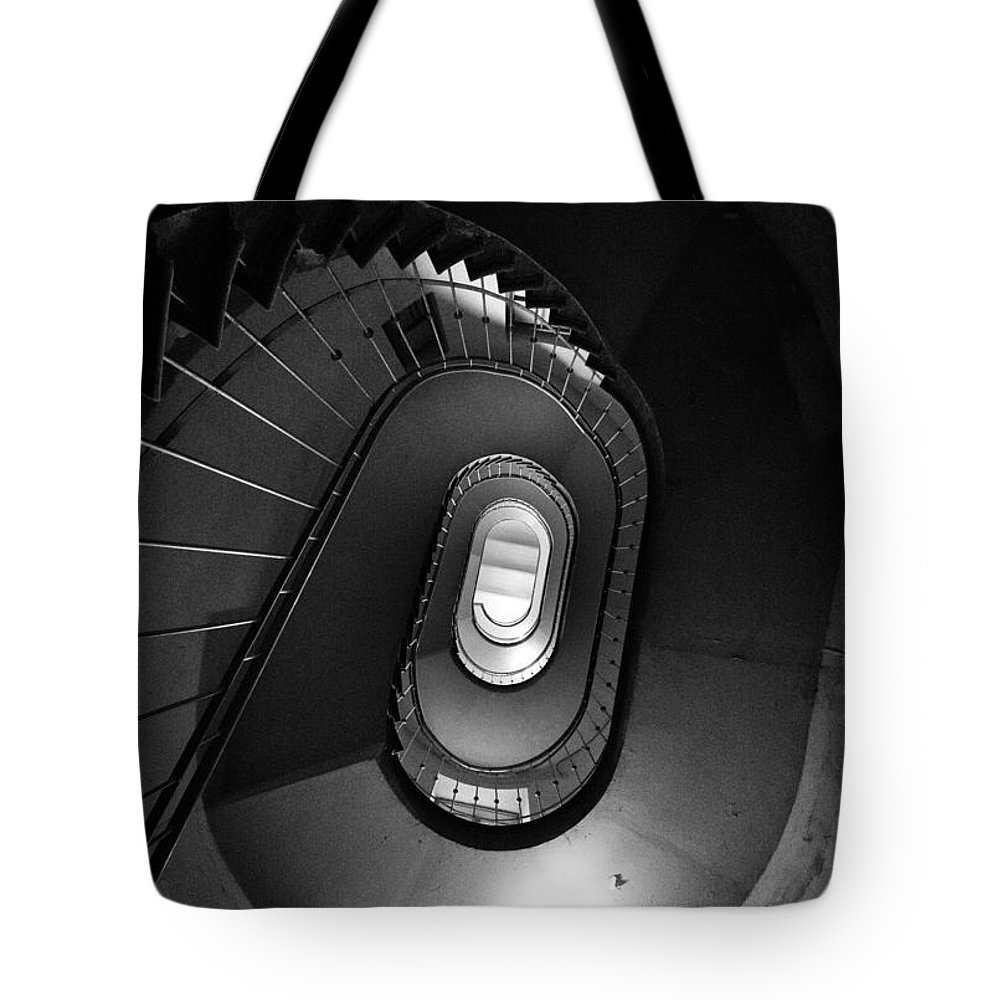 Interior View Tote Bag featuring the photograph Black And White Spiral Staircaise by Jaroslaw Blaminsky