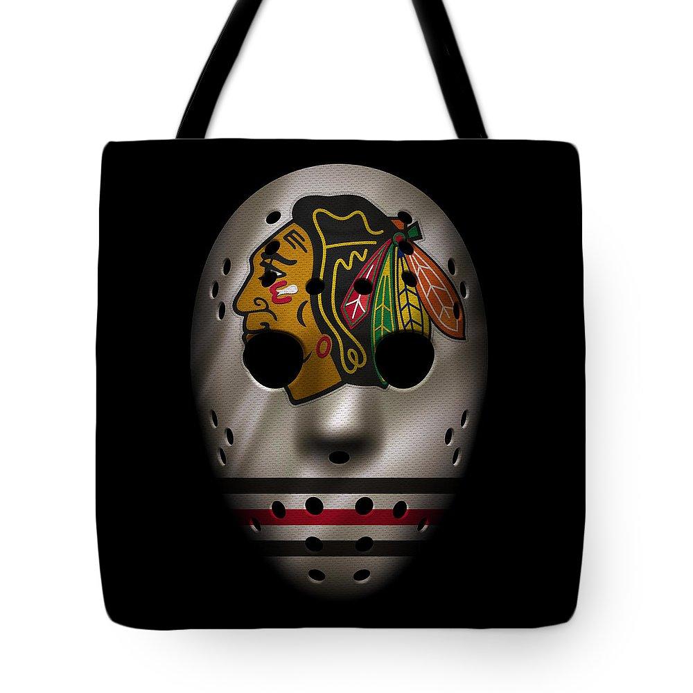 Blackhawks Tote Bag featuring the photograph Blackhawks Jersey Mask by Joe Hamilton