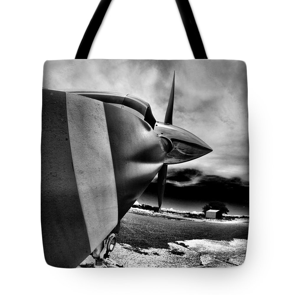Blade Tote Bag featuring the photograph Blade Flyer by Paul Job